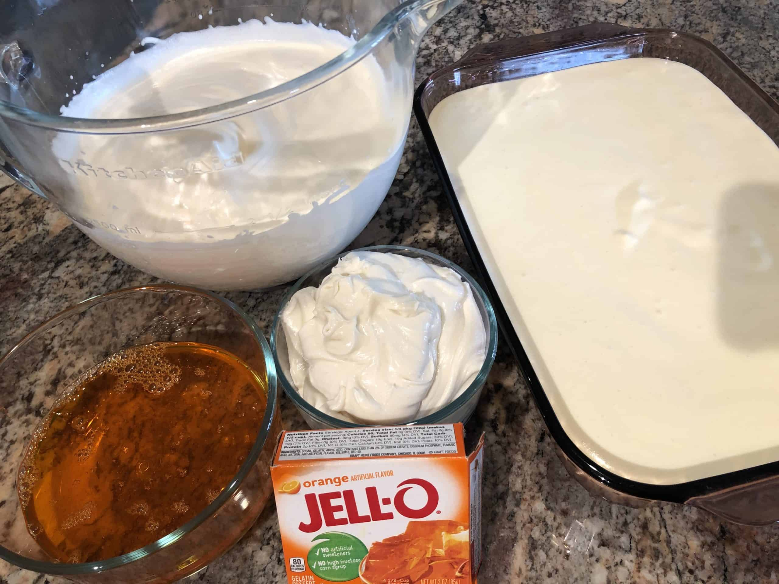 Whipped Evaporated Milk, Cream Cheese Mixture, Jello Mixture & Finished Citrus No-Bake Cheesecake Pan