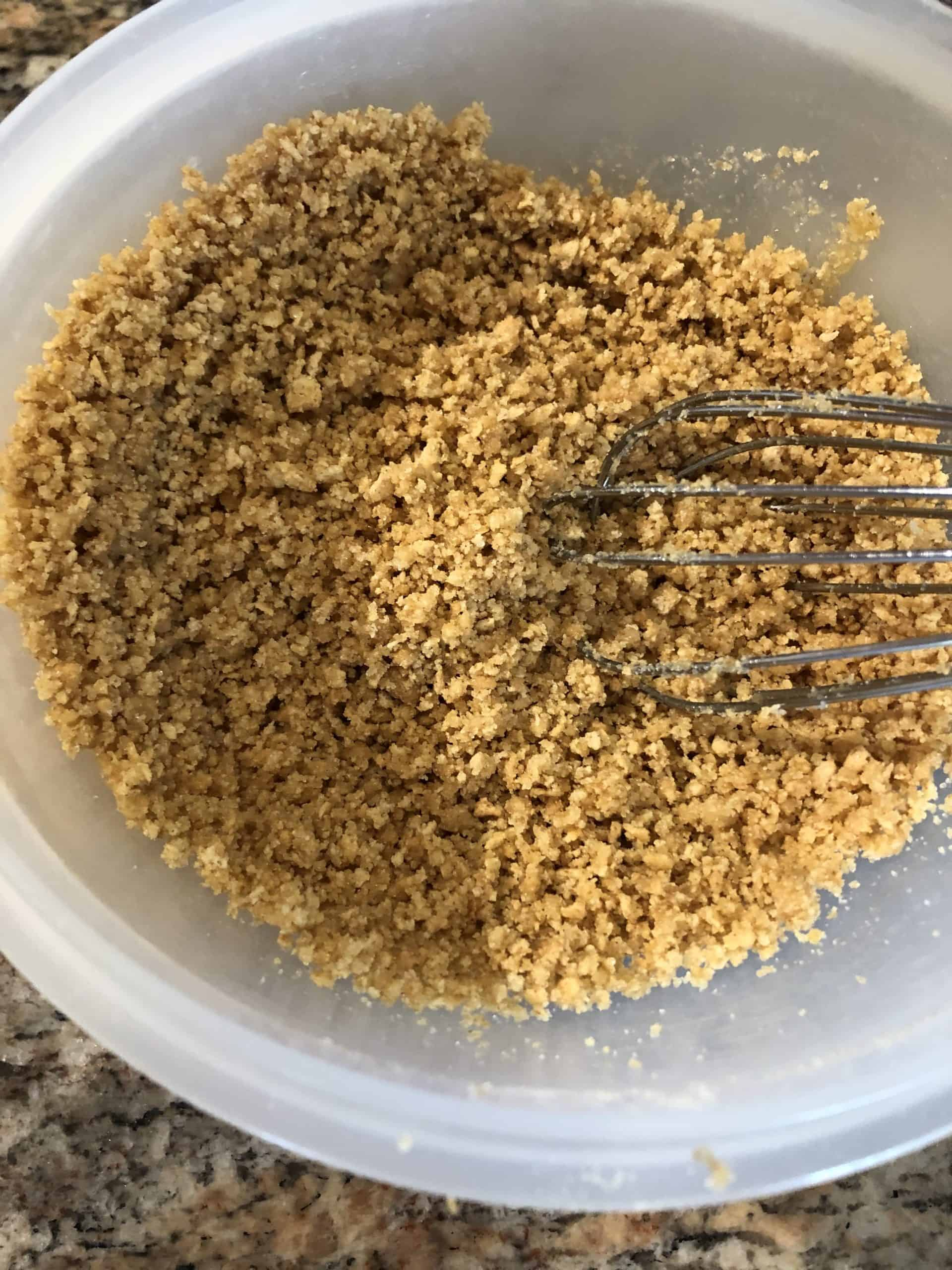 Crushed Graham Crackers in mixing bowl with whip.