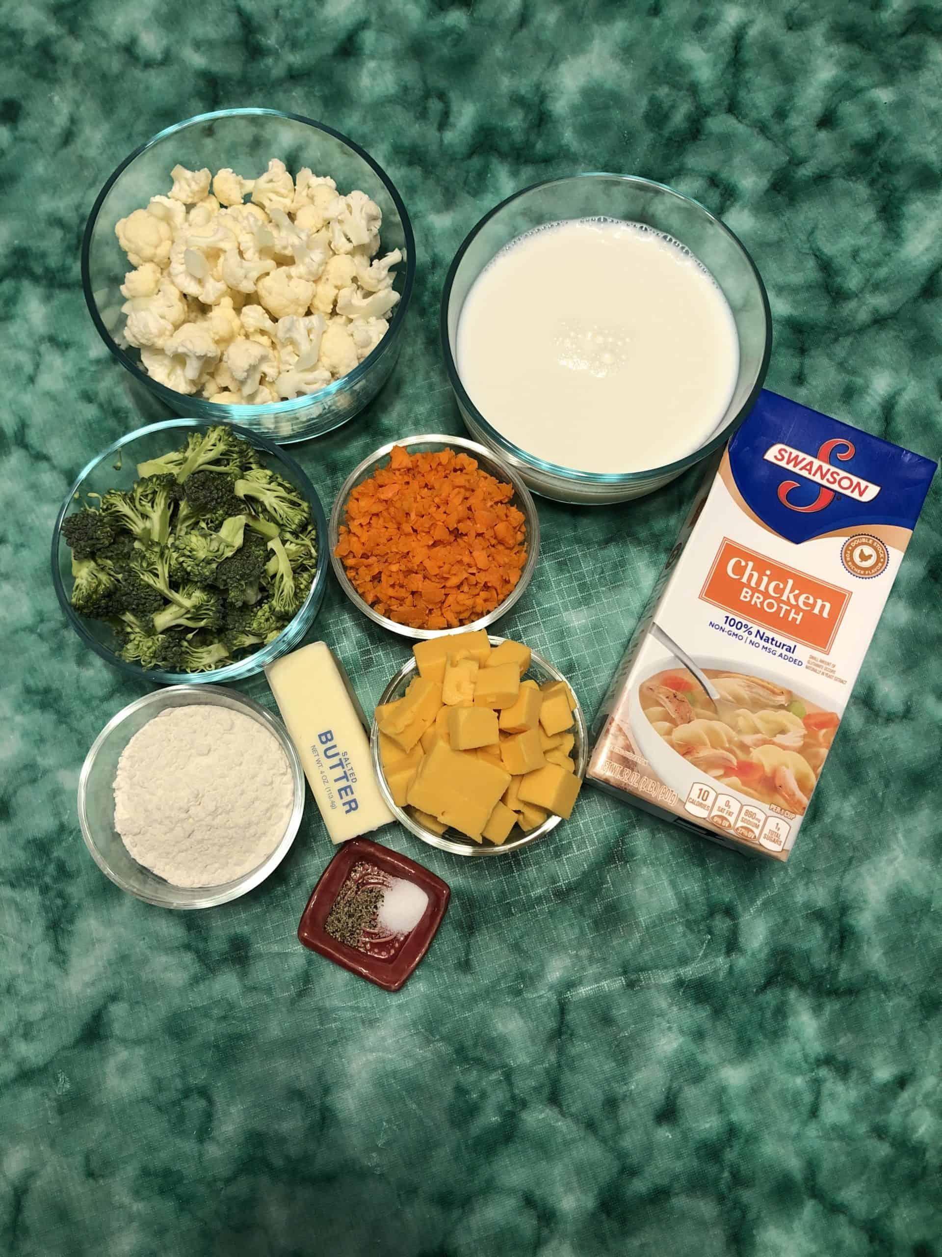 Broccoli, Cauliflower, Carrots, Velveeta Cheese, Milk, Chicken Broth, Butter, Flour, Salt and Pepper