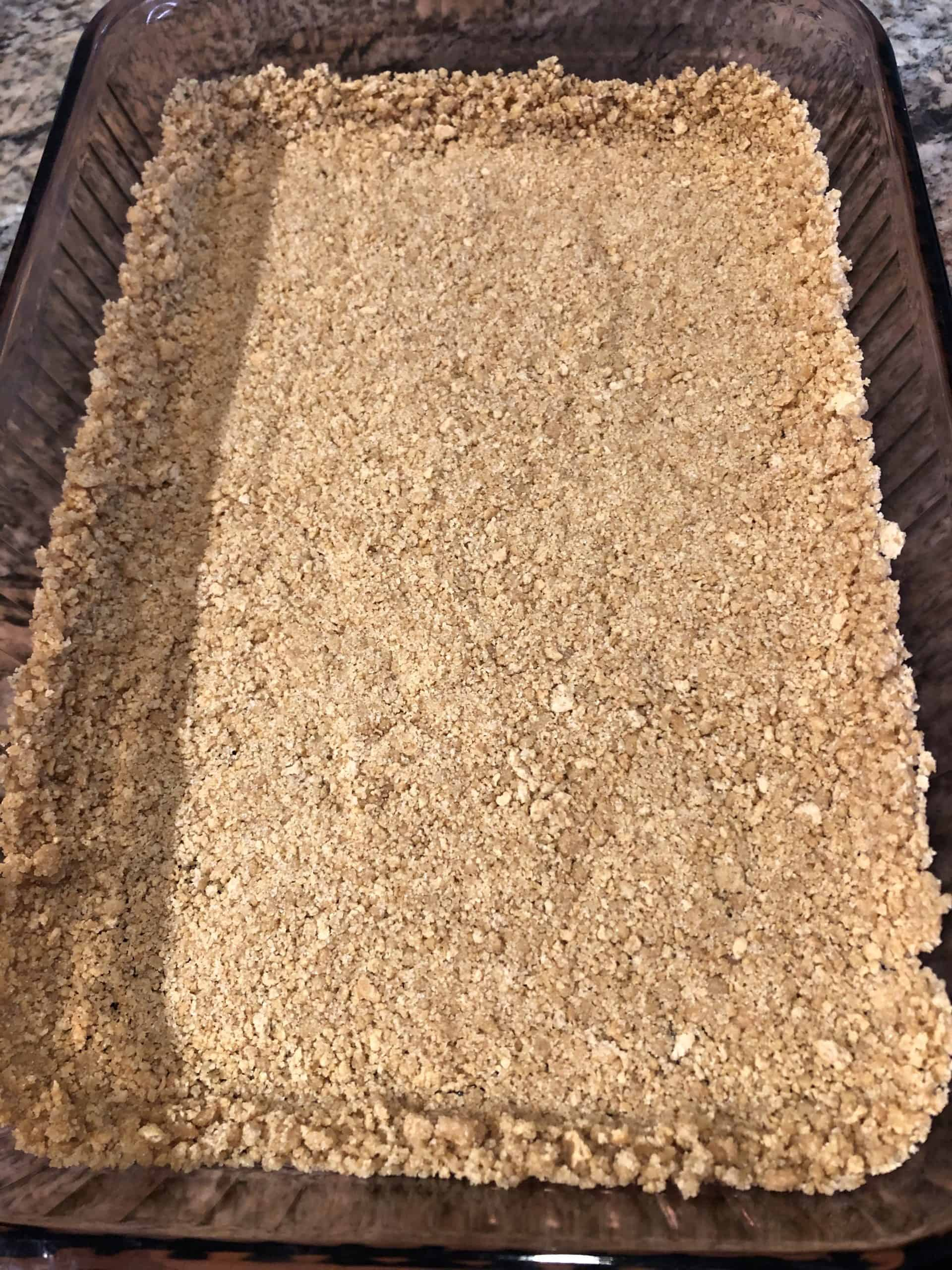 Packed Graham Cracker Crust into Baking Dish