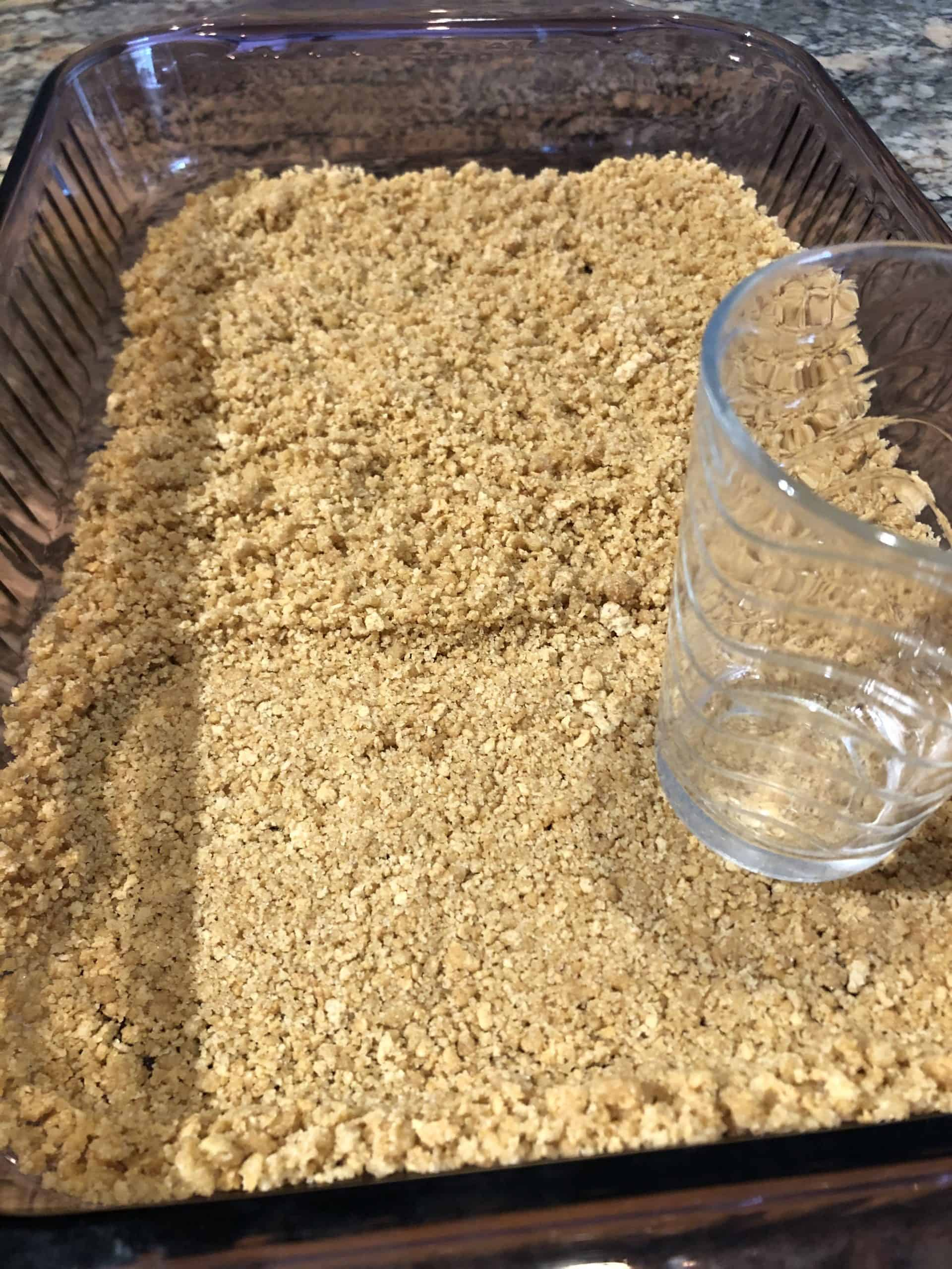 Packing Graham Cracker Crust into Baking Dish