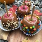 Caramel Apples with M-n-M, nuts and mini chocolate chip toppings.
