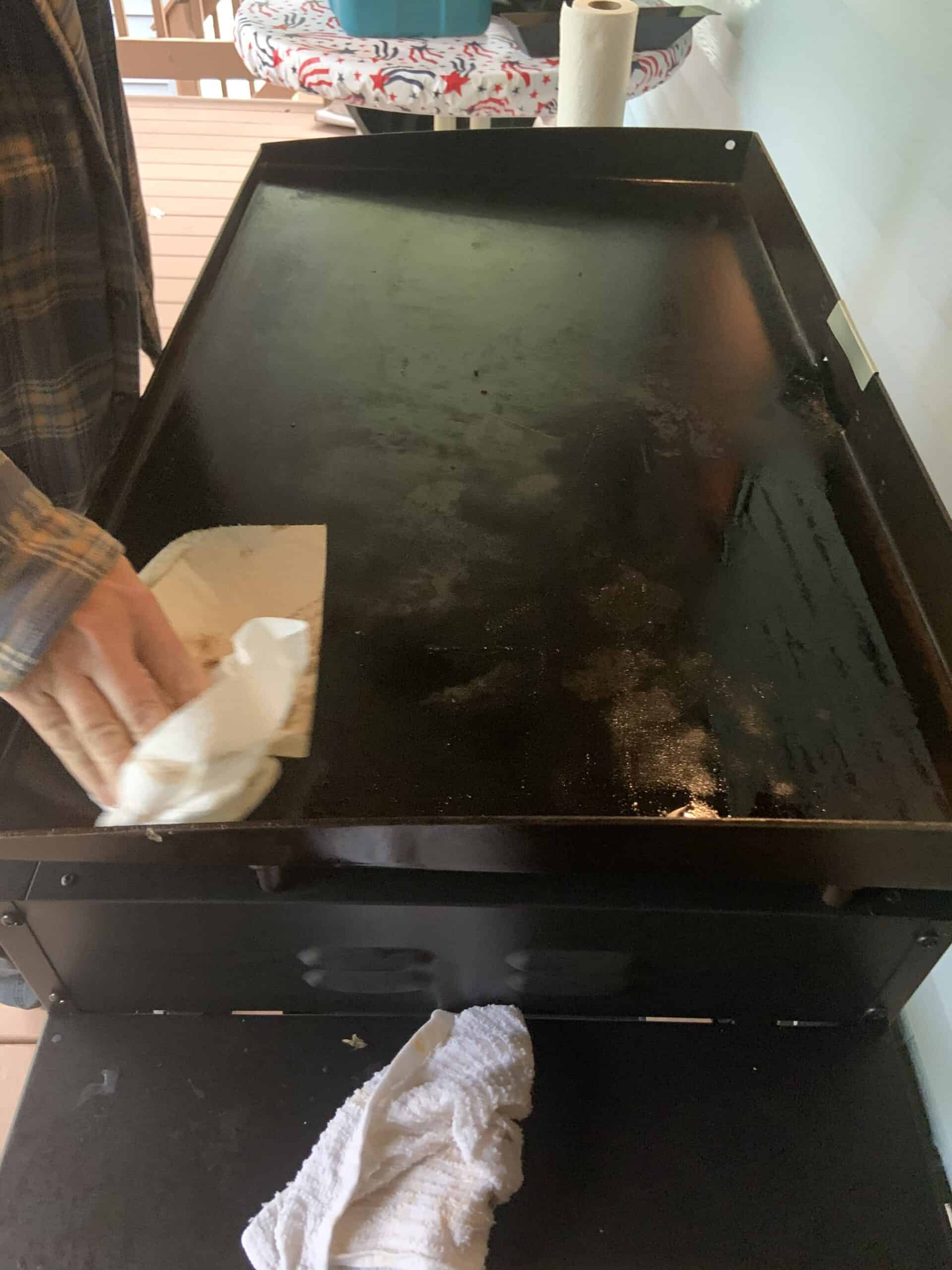 Cleaning/Seasoning Griddle Top with Oil and Paper Towel