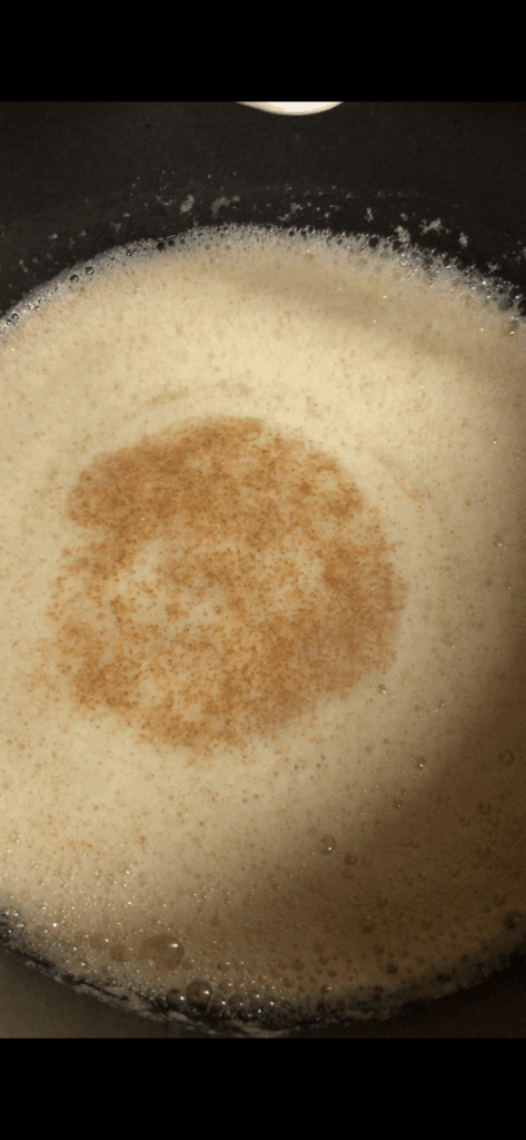 Brown butter - browned milk solids boiling in a pan.