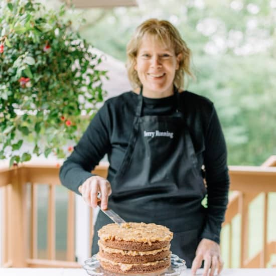 Sherry Ronning frosting a german chocolate cake.