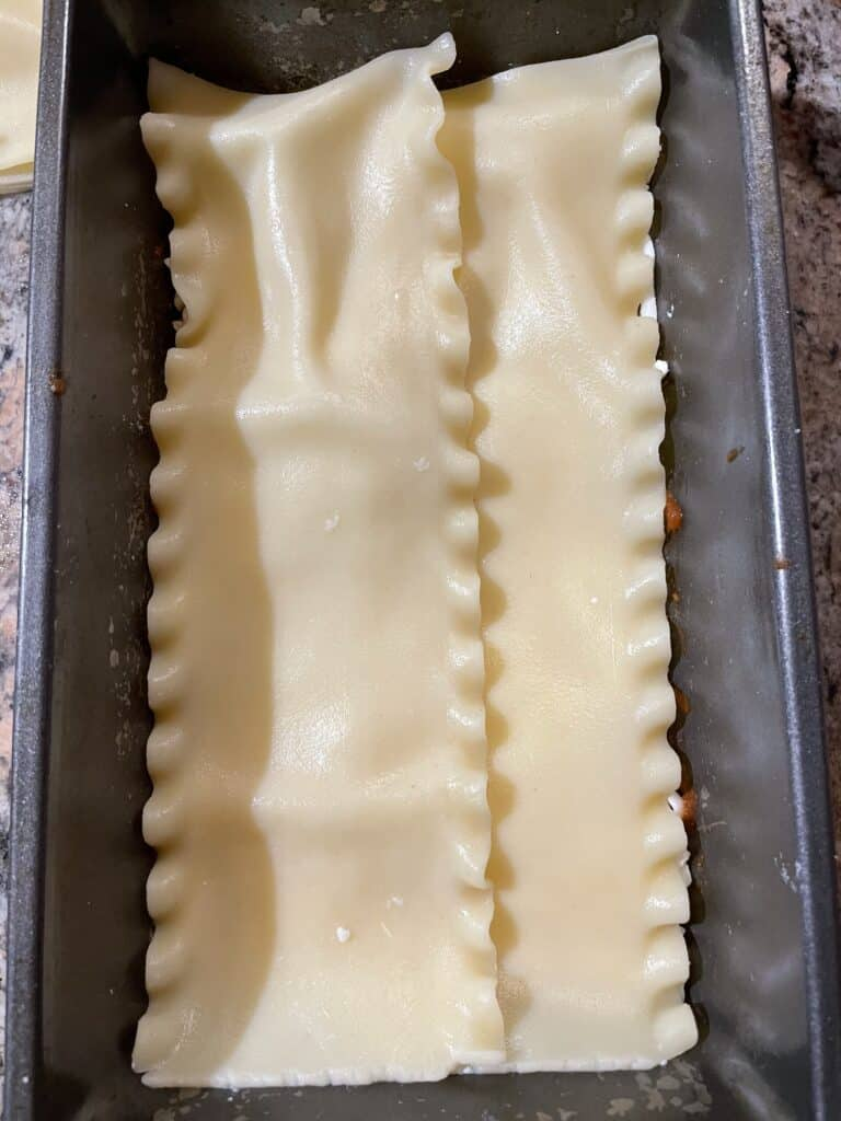 Place noodles in bottom of loaf pan
