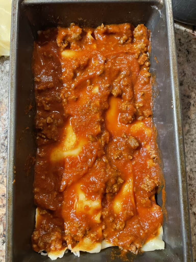 Add sauce overtop of noodles