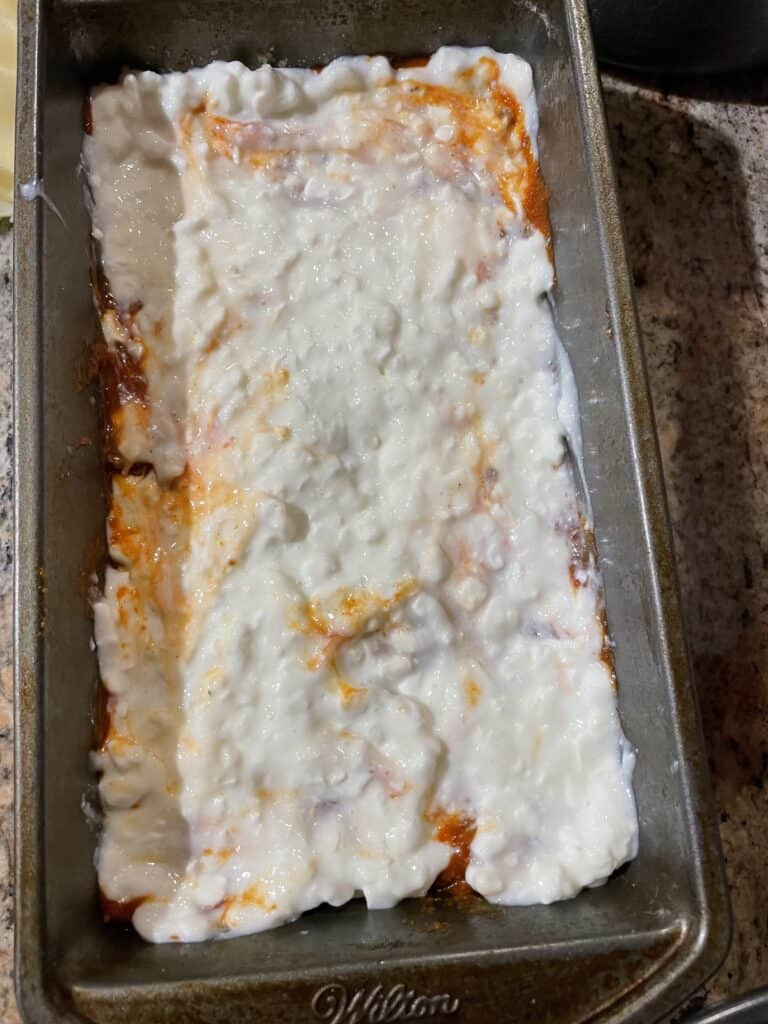 Add cottage cheese on-top of sauce layer