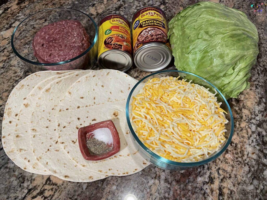 Wet Burrito Ingredients - Soft tortilla shells, hamburger, refried beans, red enchilada sauce, lettuce, shredded cheese, salt and pepper