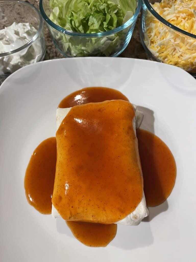 Pour red enchilada sauce over your burrito.