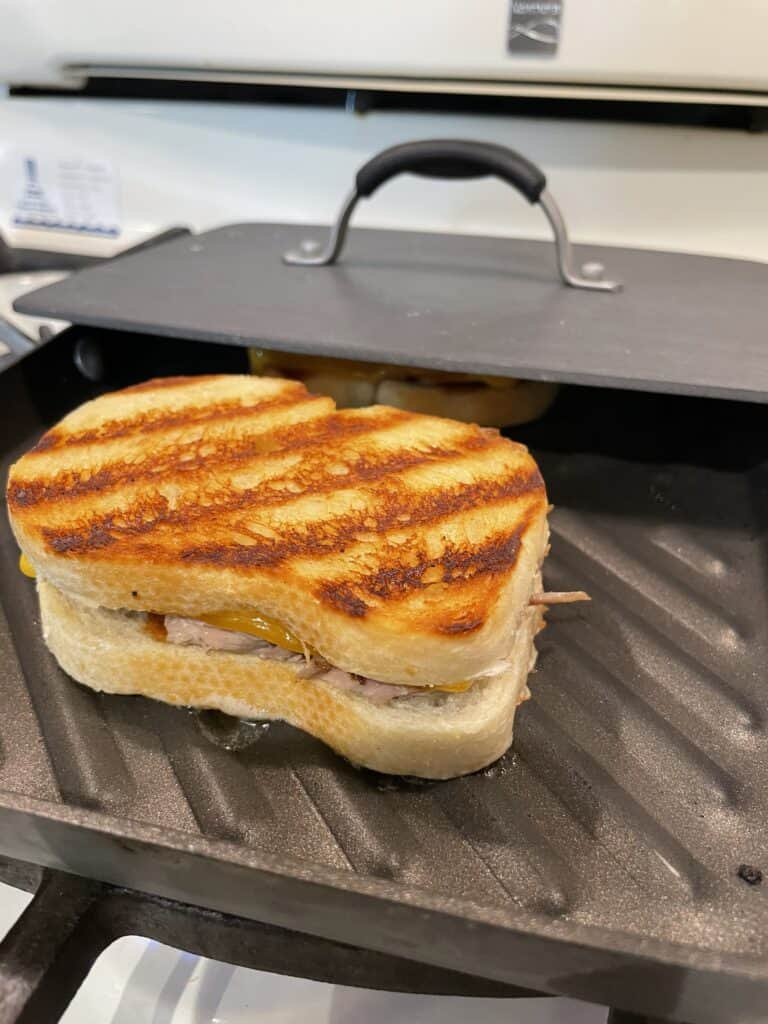 Shredded Pork Grilled Cheese Sandwich Cooked in a Panini Pan.