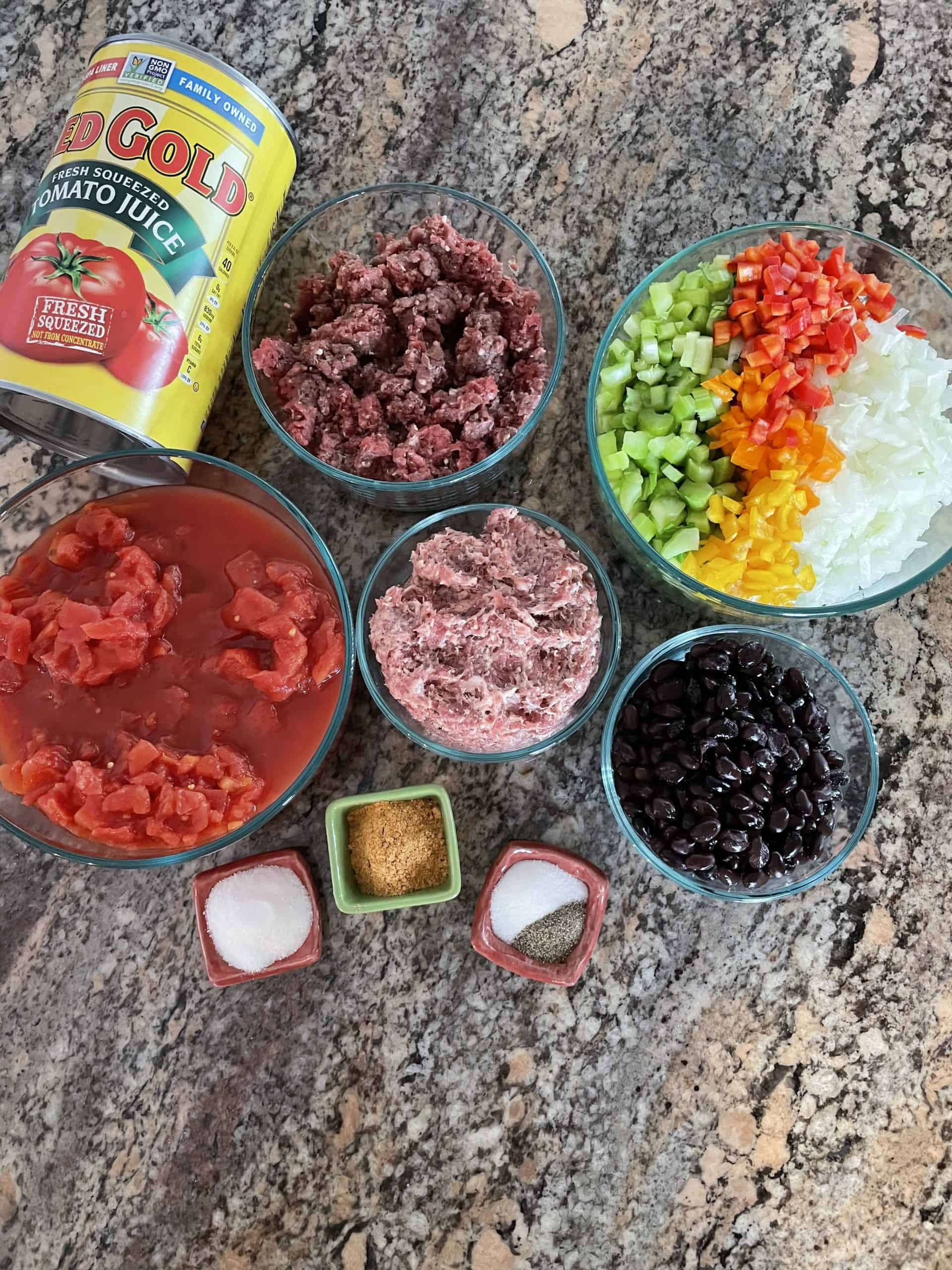 Venison Chili Ingredients - Ground venison, ground pork sausage, diced onion, peppers, & celery, diced tomatoes, taco seasonings, salt, pepper, sugar, tomato juice and black beans.