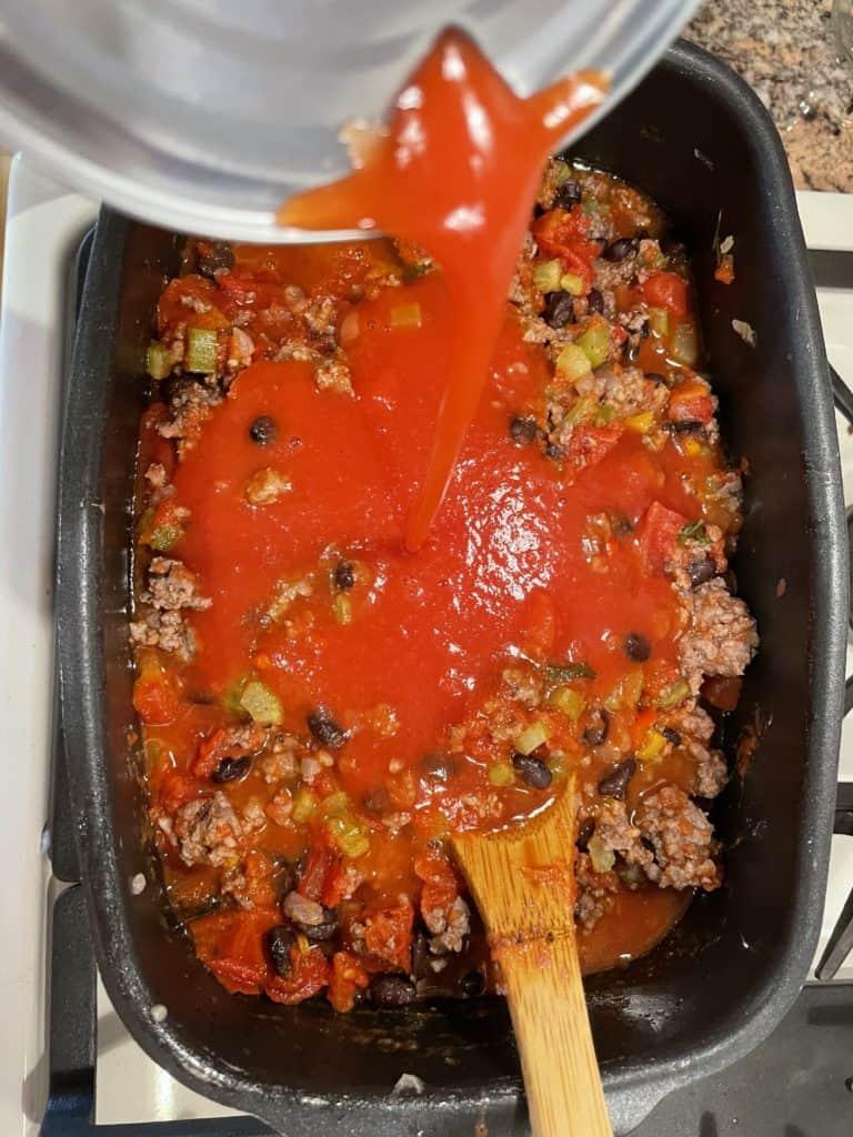 Add Tomato Juice to venison chili.