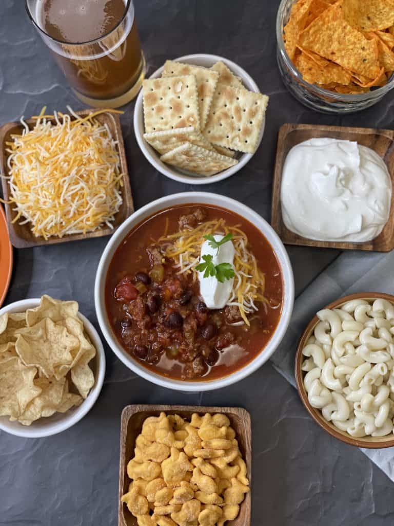 Venison Chili Bar - Chili, Sour Cream, Shredded Cheese, Saltine Crackers, Cooked Noodles, Tortilla Chips, & Gold Fish Crackers