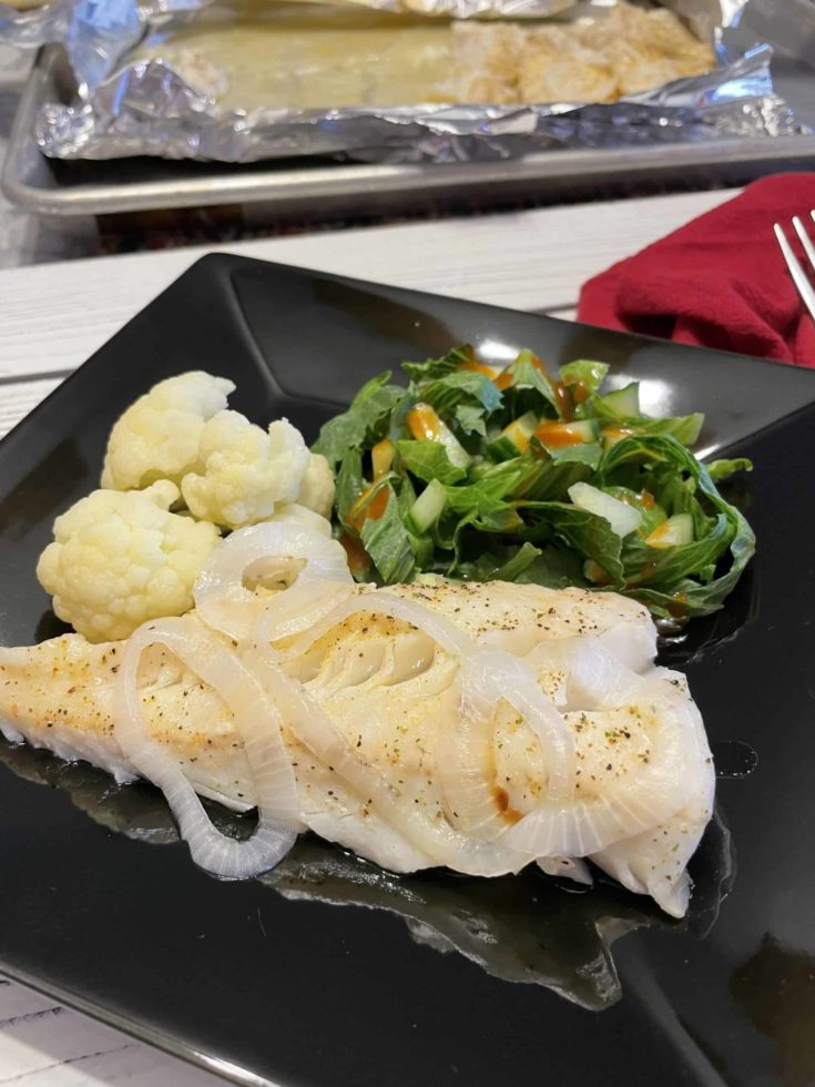 Oven-Baked Walleye Recipe with steamed cauliflower and a side salad.