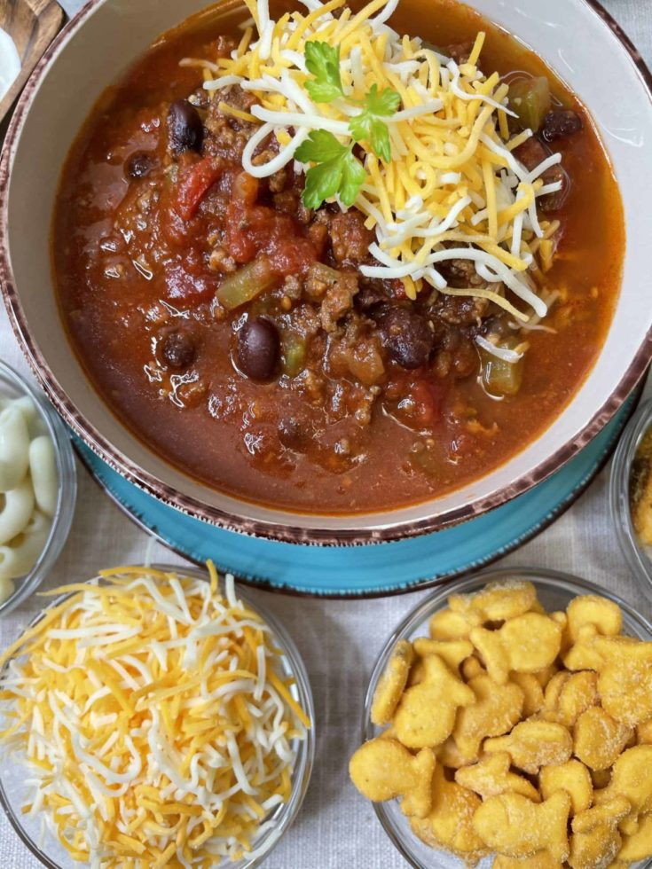 Black Bean Chili with Shredded Cheese, Gold fish, and Cooked Noodles.