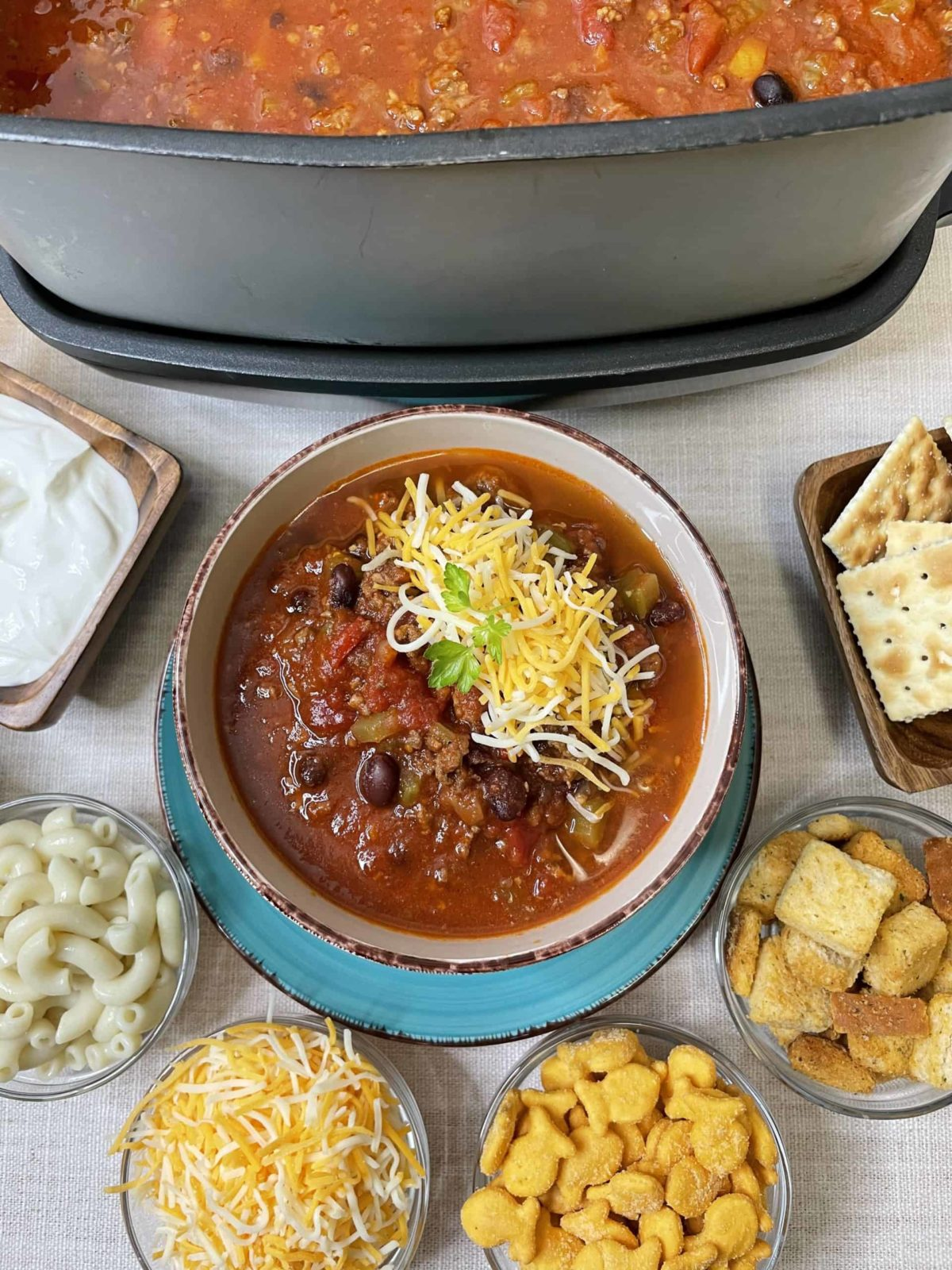 Slow Cooker Chili with Condiments on the side.