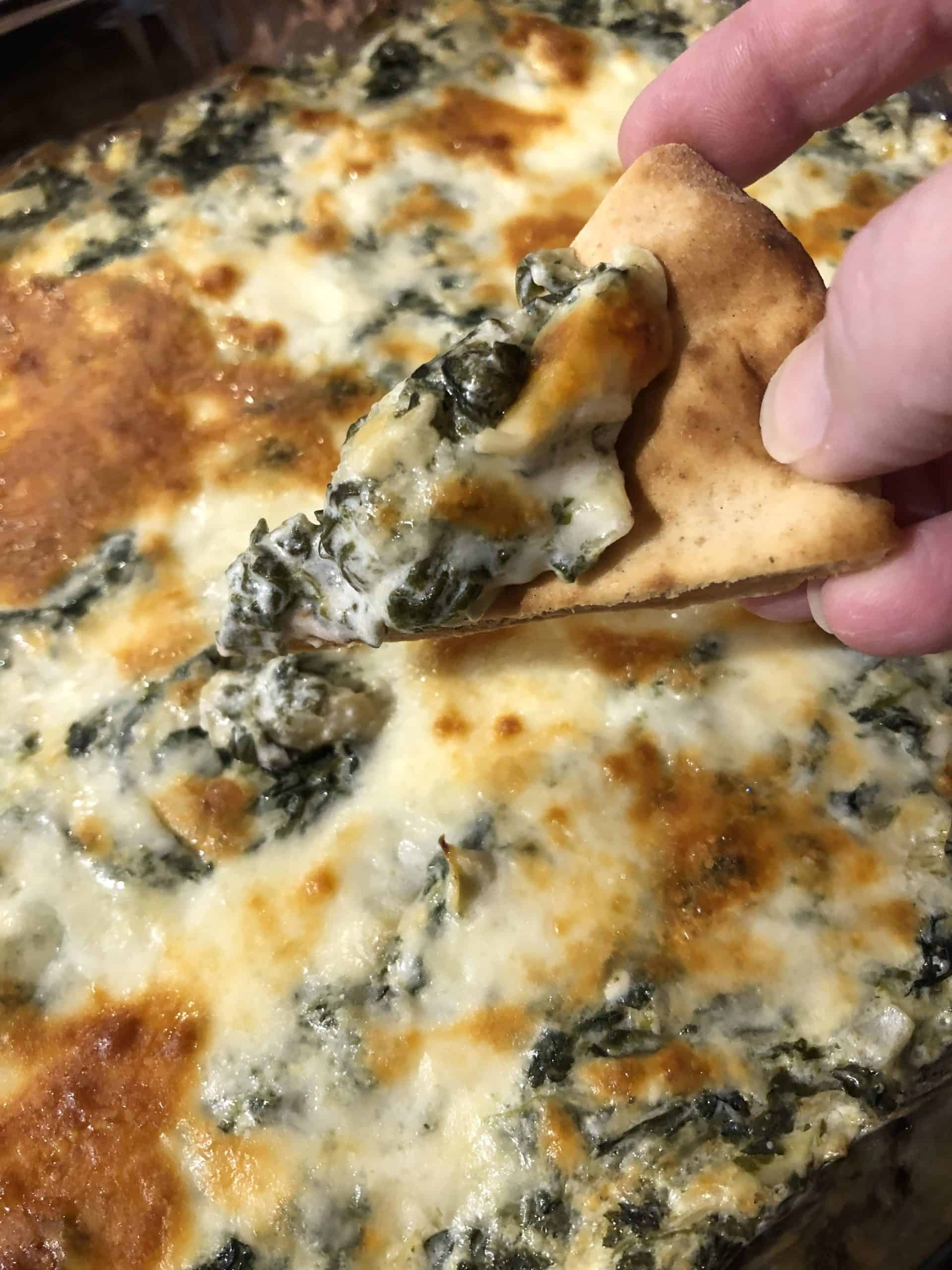 Pita bread dipped in Baked Spinach Artichoke Dip