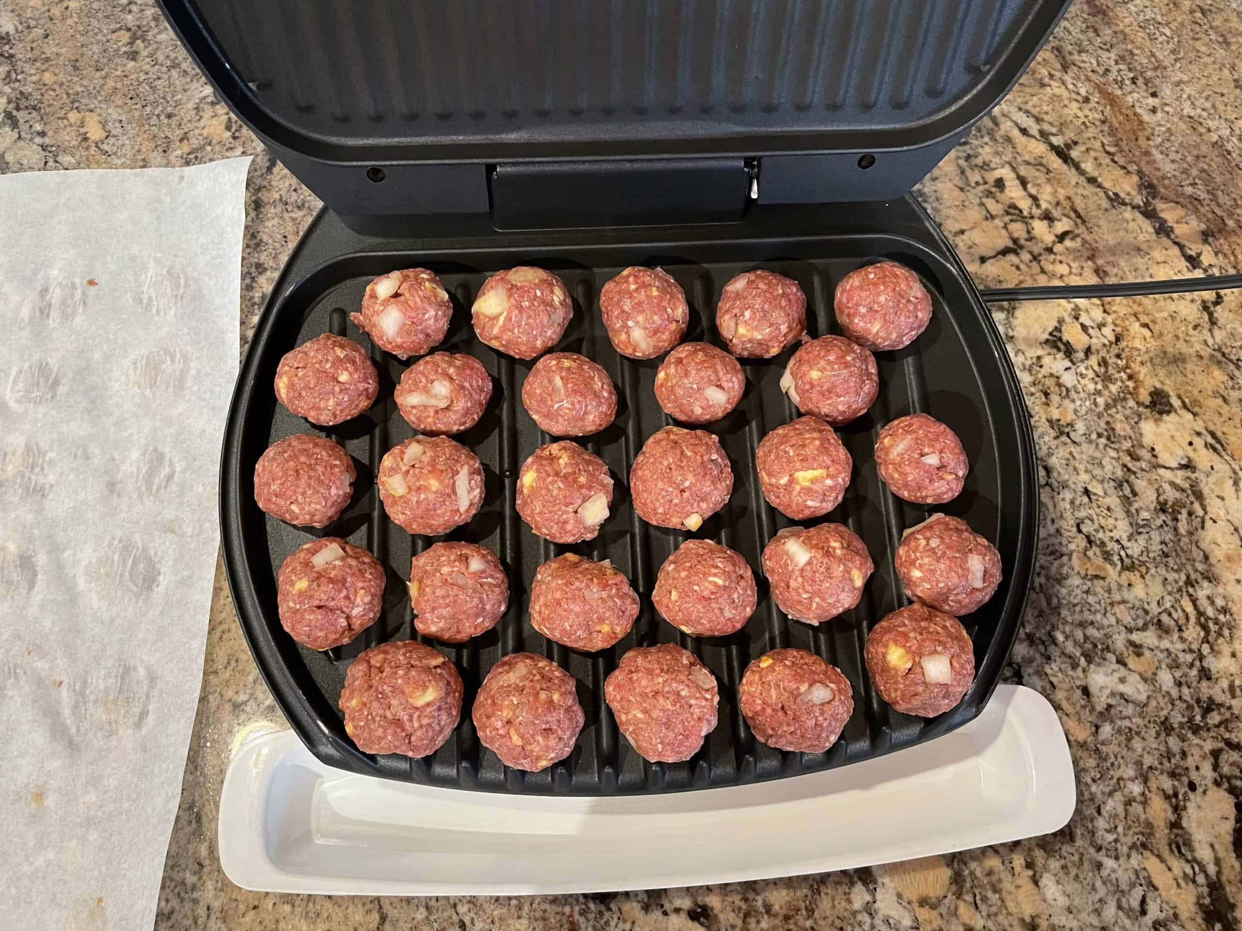 Browning meatballs on George Forman griddle.