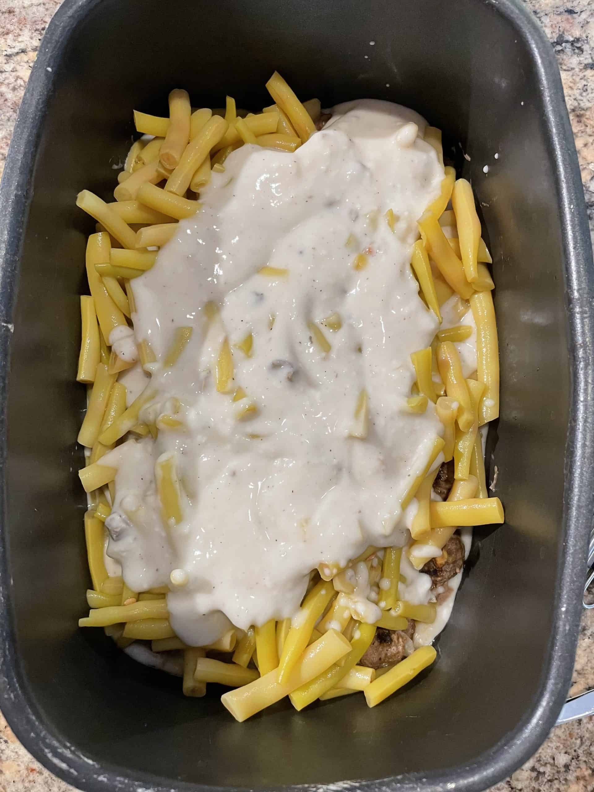 Yellow beans topped with cream of mushroom soup.