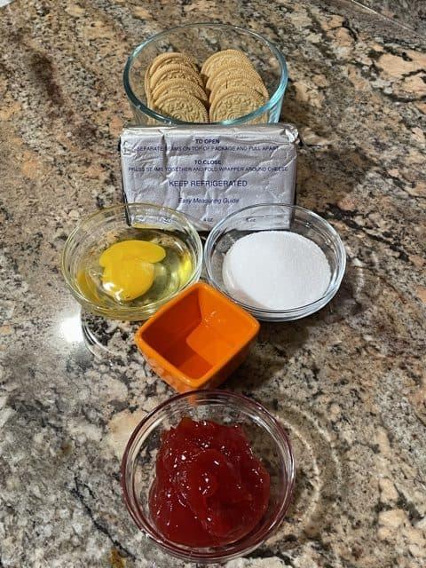 Cheesecake Ingredients - cream cheese, sugar, egg, golden Oreo, vanilla and fruit topping