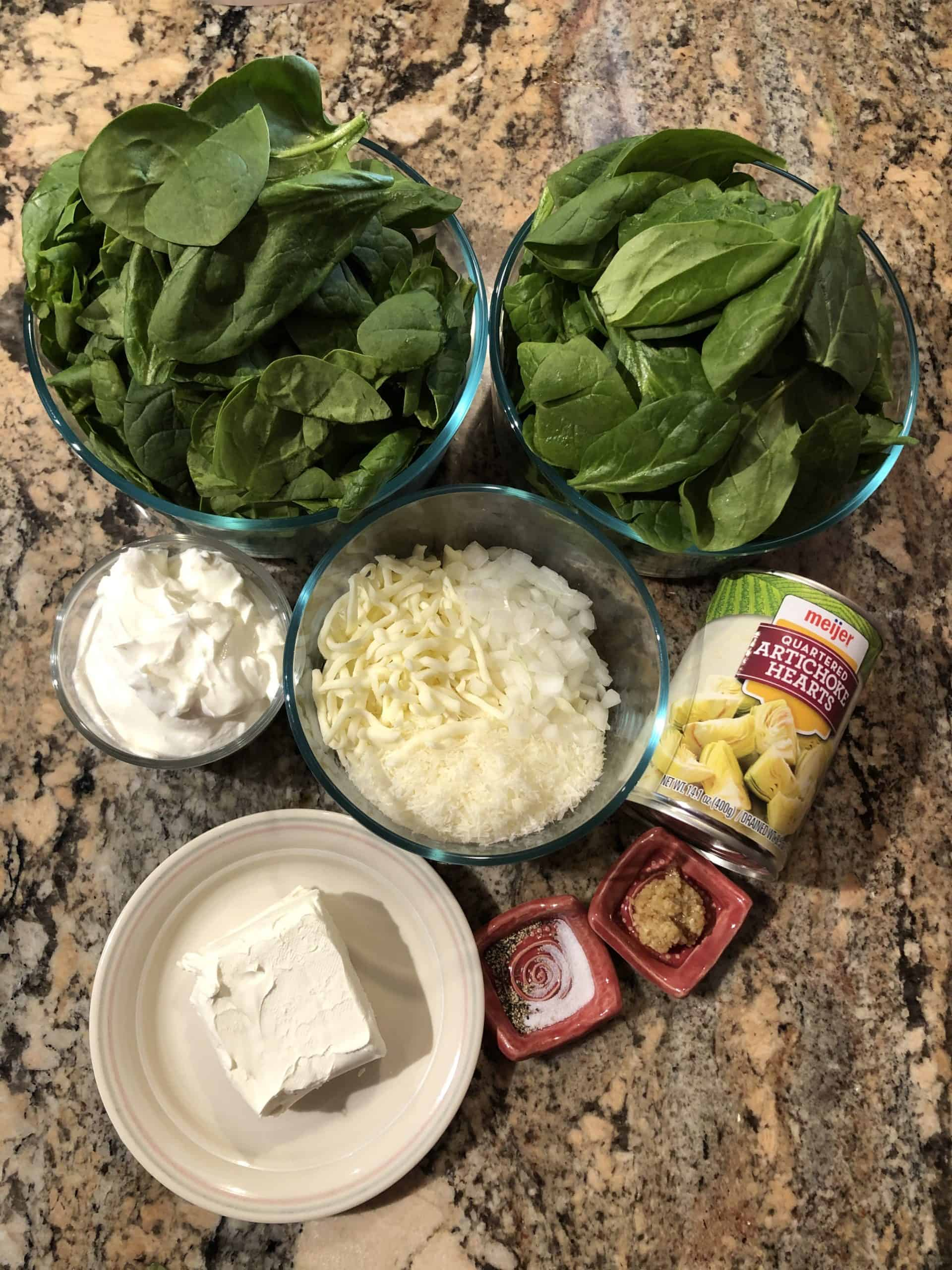 Baked Spinach Artichoke Dip ingredients - fresh spinach, canned artichoke hearts, 3 kinds of cheeses, sour cream and seasonings.