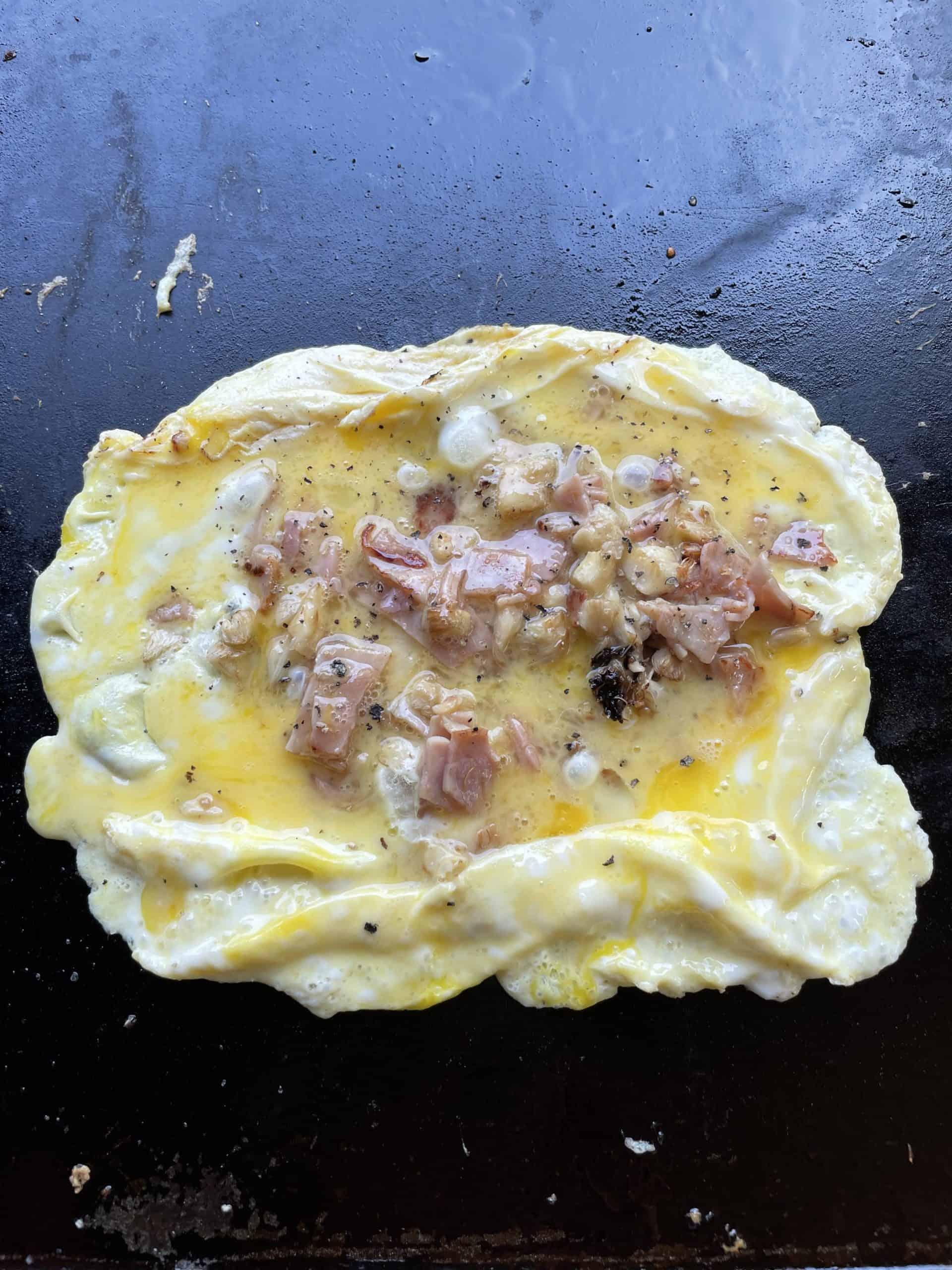 Add Sautéed Ham and Mushroom to Egg Omelette