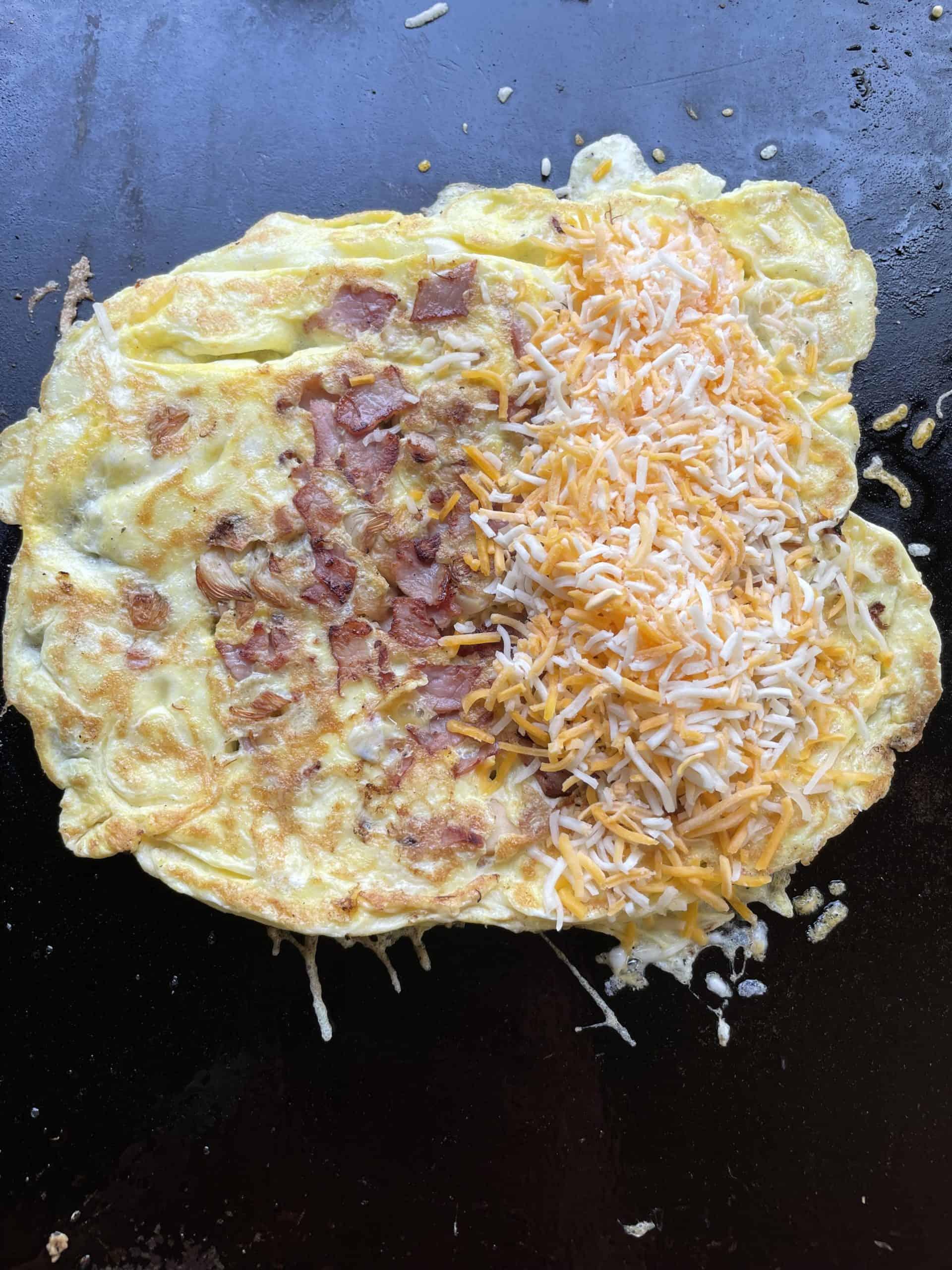 Shredded Cheese added to Half of Omelette.