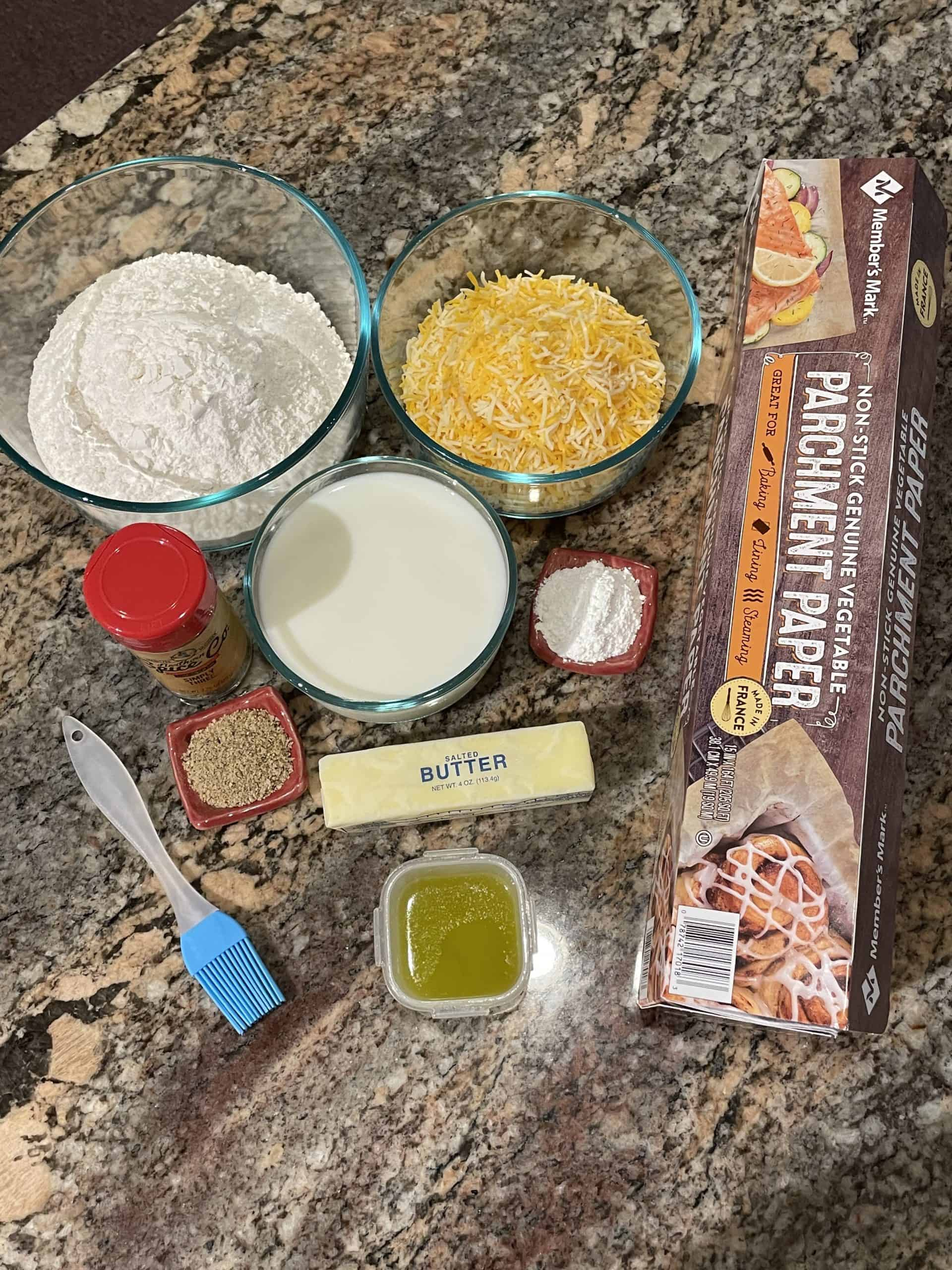 Cheddar Biscuits Ingredient - Flour, baking powder, Simply Three seasoning, butter, shredded cheddar cheese, and milk.
