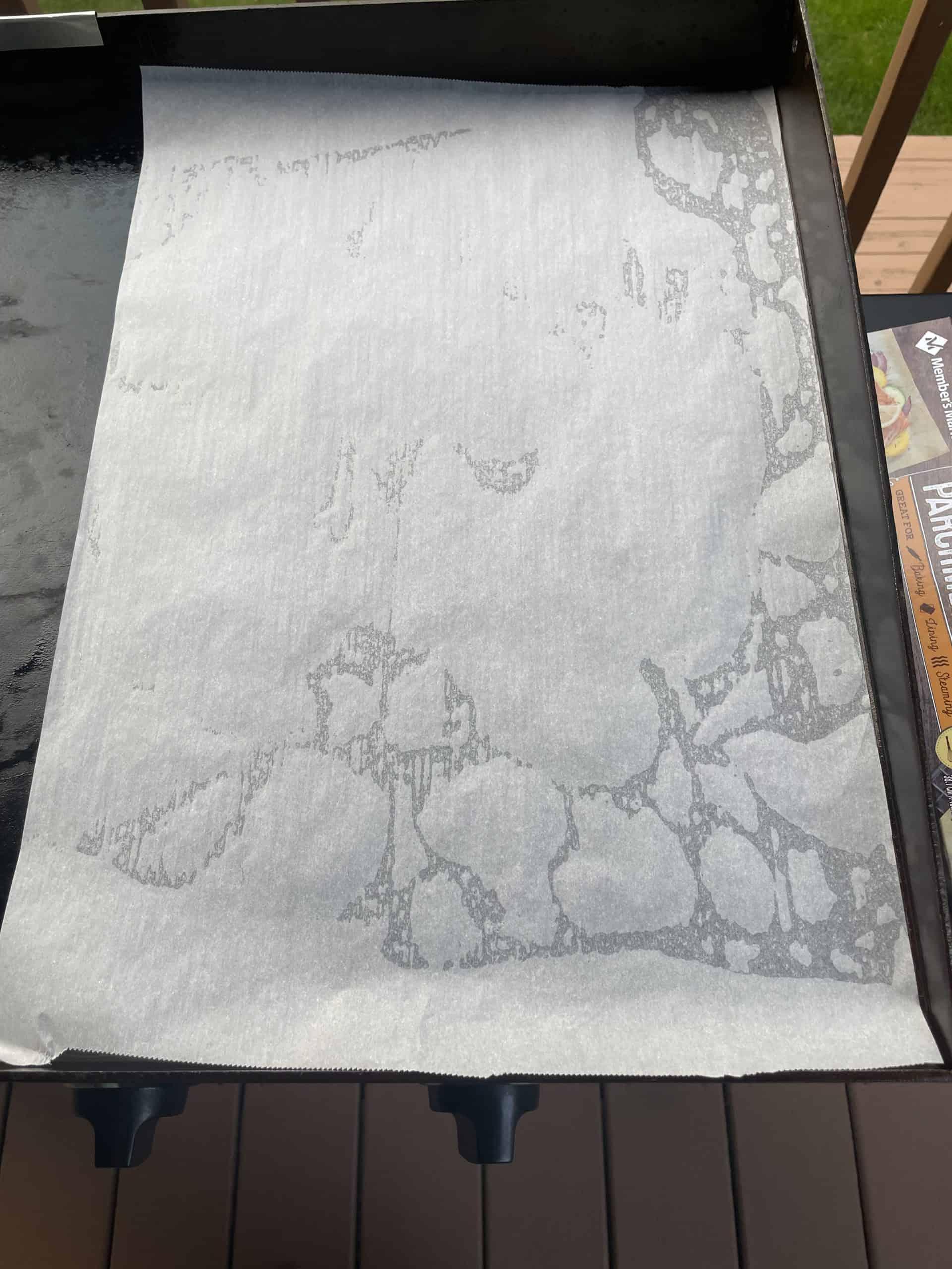 Parchment Paper on top of Blackstone Griddle.