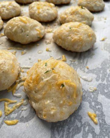 Cheddar Biscuits baked on a griddle.