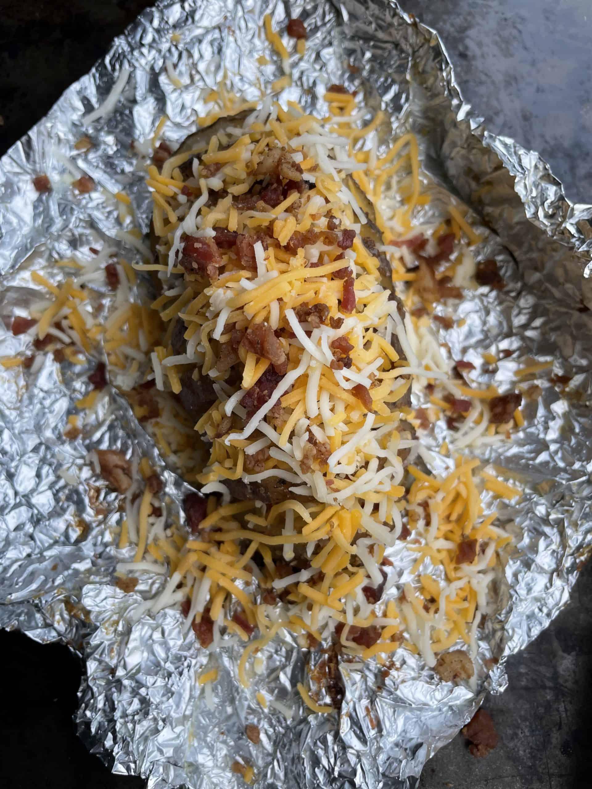 Sprinkle Shredded Cheese  On-top Of Sliced Potato