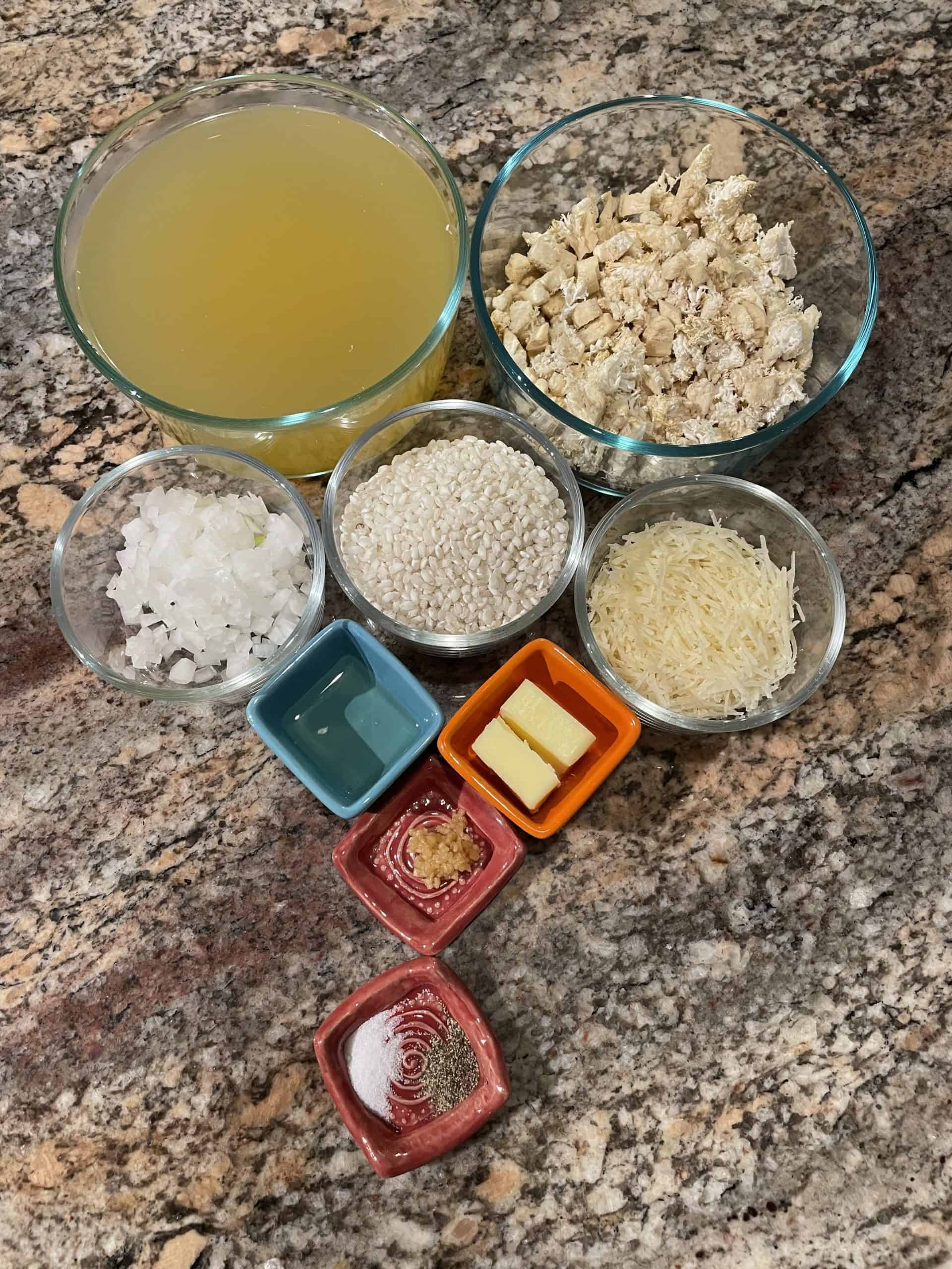 Risotto Ingredients - rice, broth, diced onion & mushrooms, minced garlic, butter, oil, seasonings and parmesan.