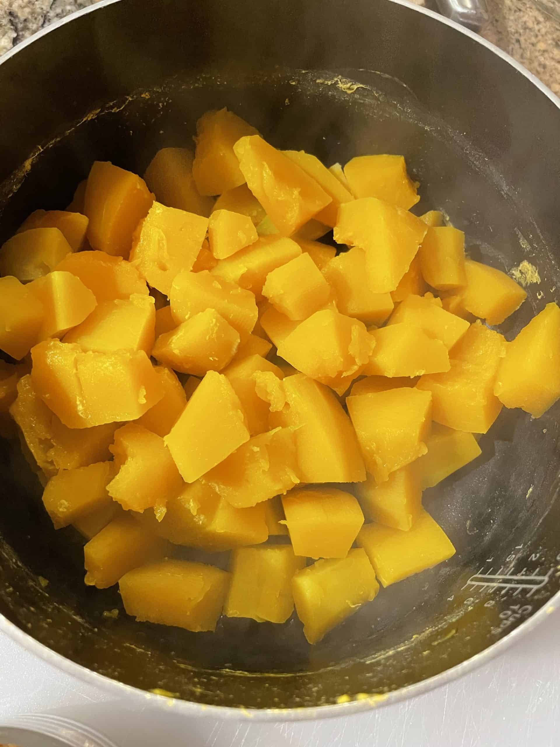 Drain the water off of the cooked squash.