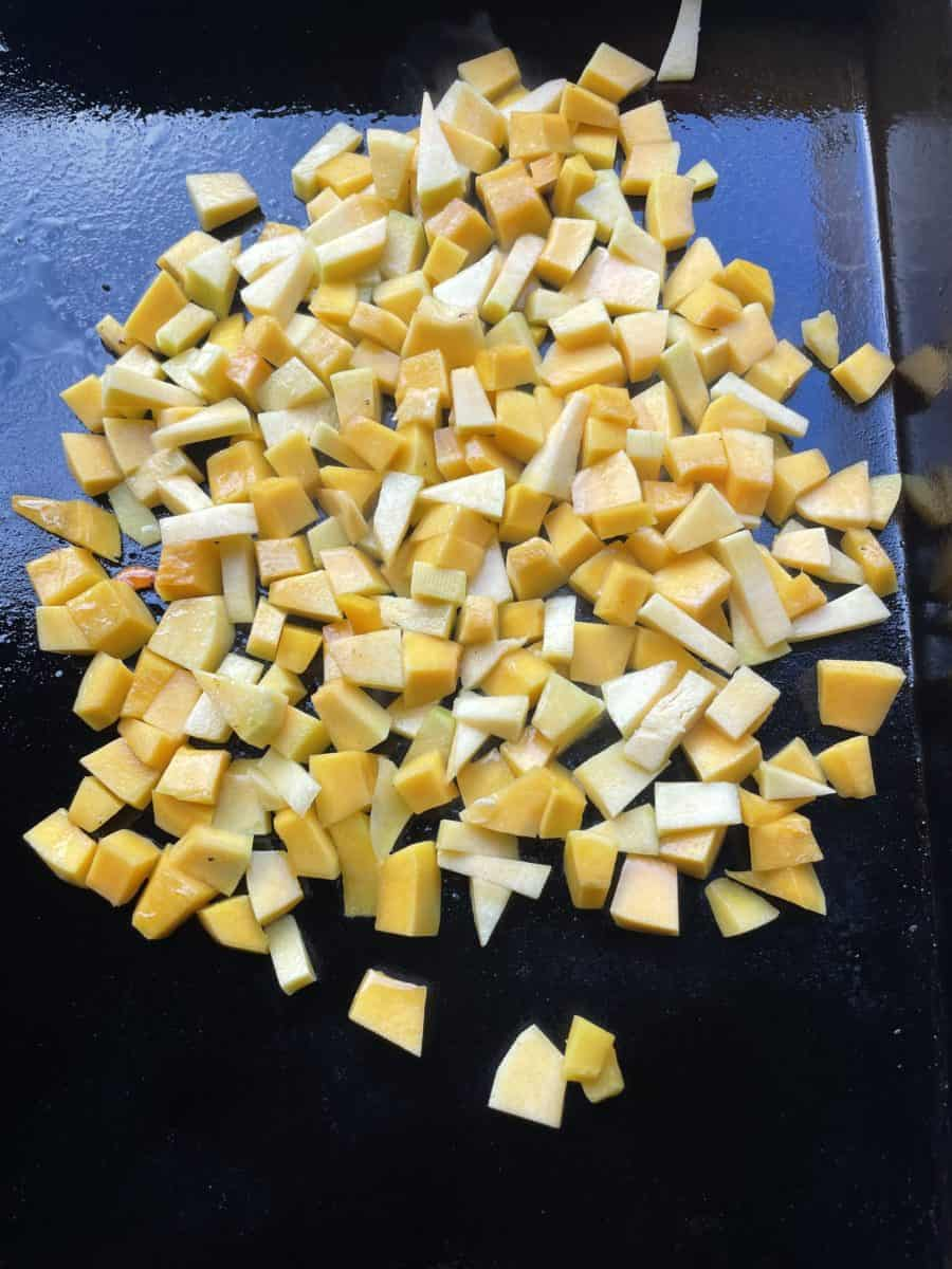 Cooking Blackstone Griddle Grilled Butternut Squash pieces.