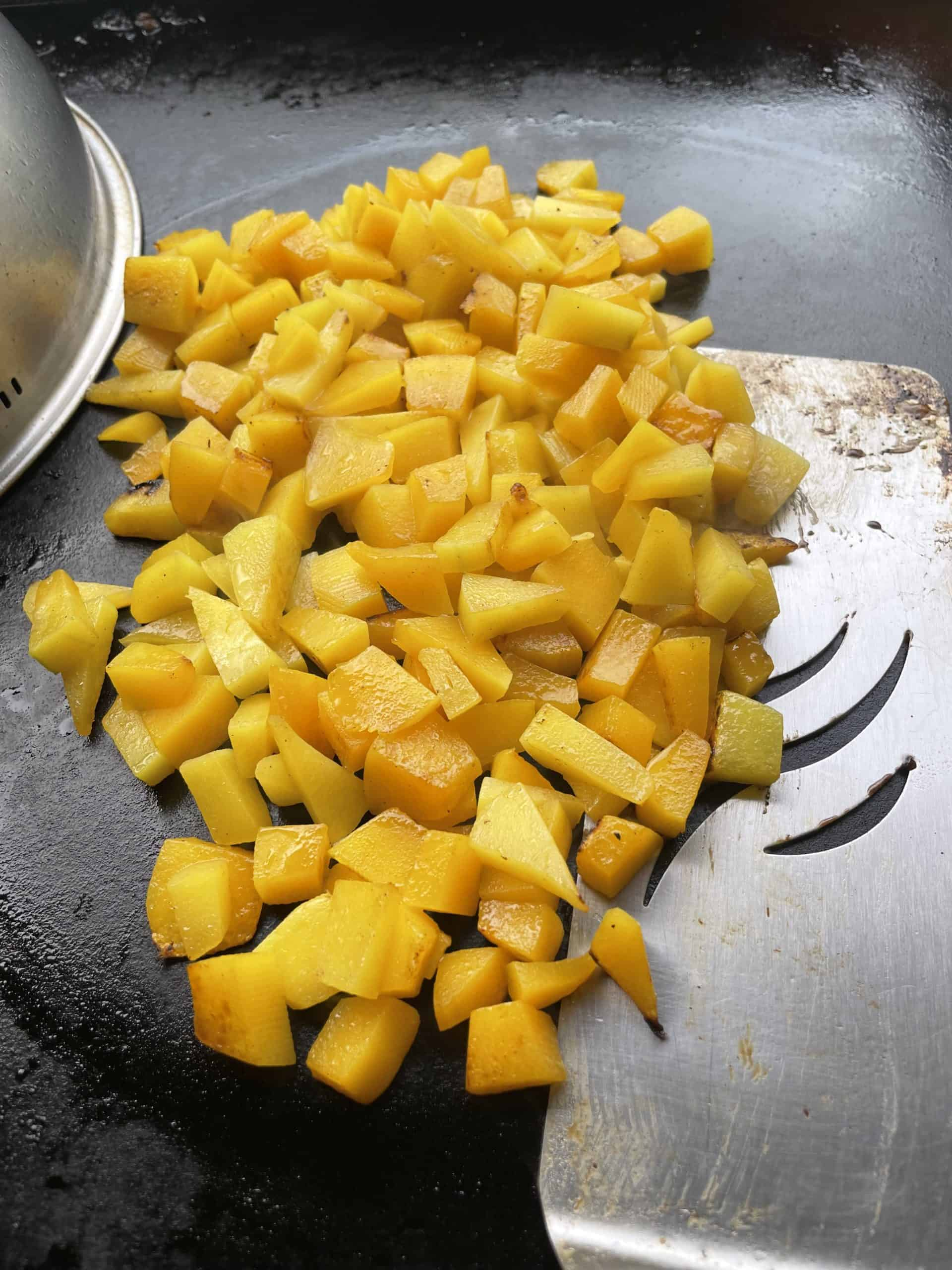 Blackstone Griddle Grilled Butternut Squash in bite sized pieces.