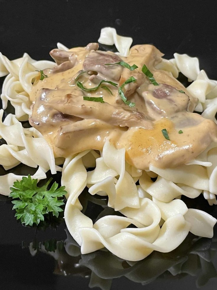Lion's Mane Mushroom Cream Sauce with Beef on top of egg noodles.