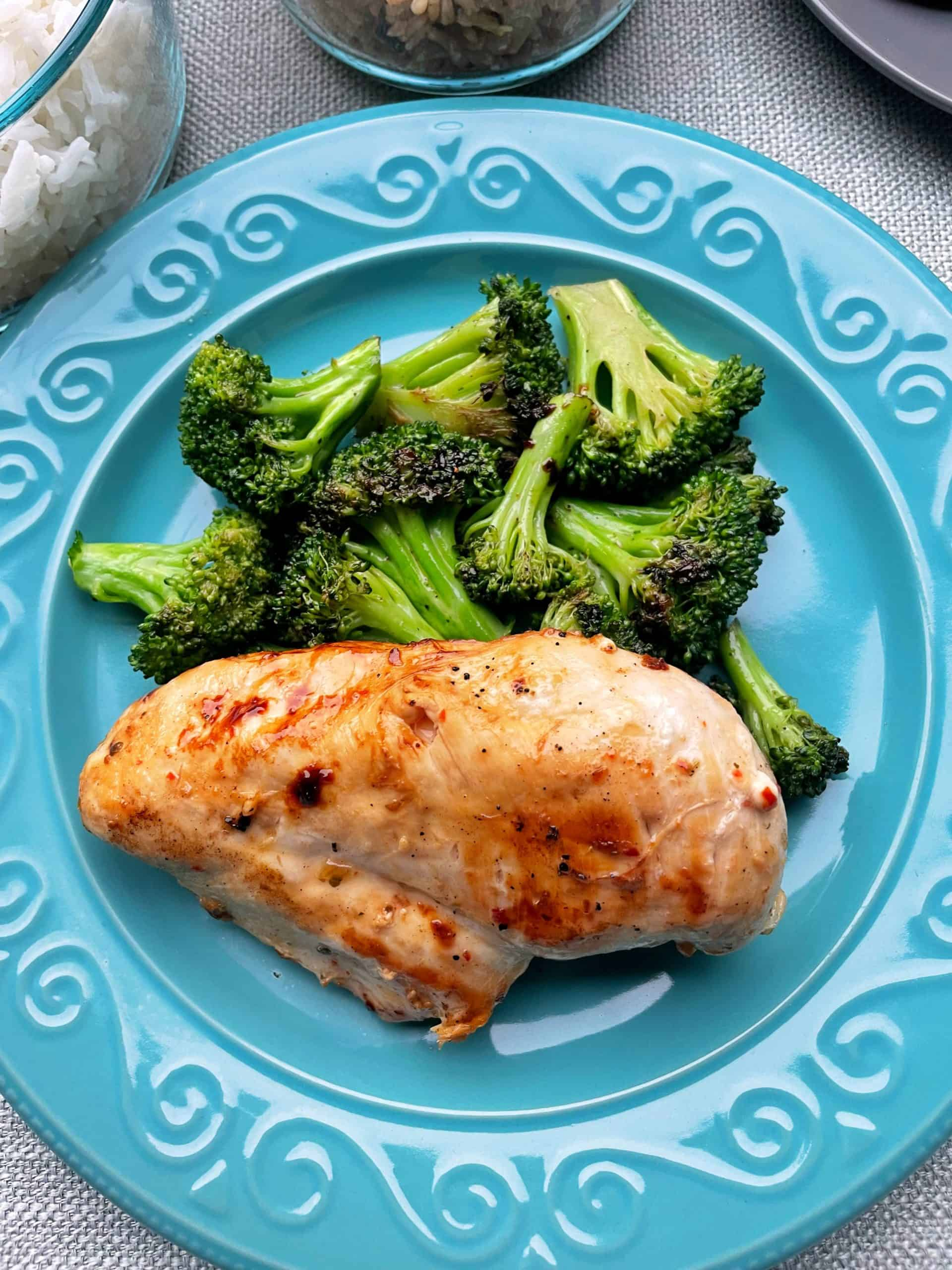 Best Marinated Chicken Recipe on  a plate with steamed Broccoli.