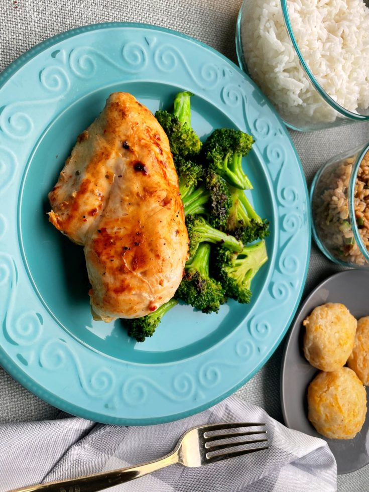 Blackstone Griddle Marinated Chicken Breast on a plate with steamed Broccoli.
